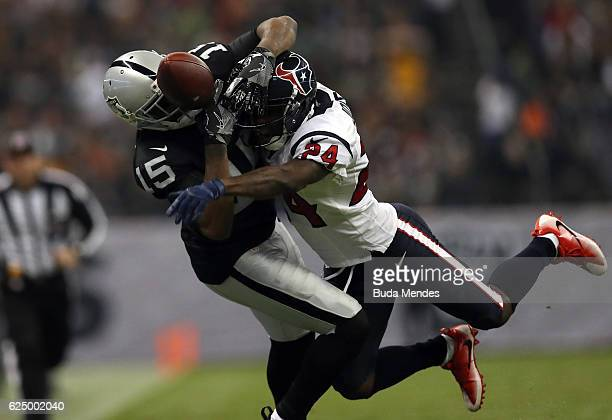 Johnathan Joseph of the Houston Texans breaks up a pass to Michael Crabtree of the Oakland Raiders in their game at Estadio Azteca on November 21...