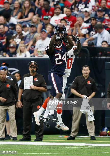 Johnathan Joseph of the Houston Texans intercepts the ball against the Cleveland Browns at NRG Stadium on October 15 2017 in Houston Texas