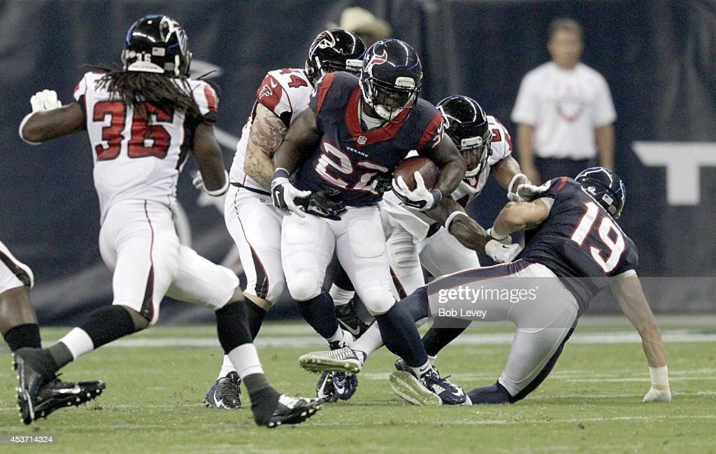 Johnathan Joseph #24 of the Houston Texans is tackled by Pat Angerer #44 of the Atlanta Falcons in the third quarter in a pre-season NFL game on August 16, 2014 at NRG Stadium in Houston, Texas.