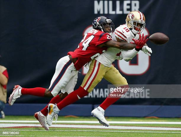 Johnathan Joseph of the Houston Texans knocks the ball away from Louis Murphy of the San Francisco 49ers in the second half at NRG Stadium on...