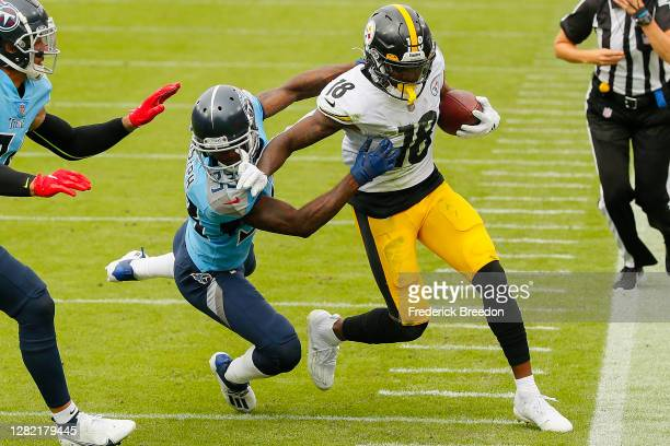 Johnathan Joseph of the Tennessee Titans pushes Diontae Johnson of the Pittsburgh Steelers out of bounds during the first half at Nissan Stadium on...