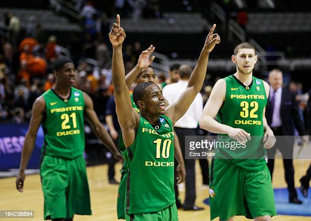 Johnathan Loyd Damyean Dotson and Ben Carter of the Oregon Ducks celebrate their 68 to 55 win over the Oklahoma State Cowboys during the second round...