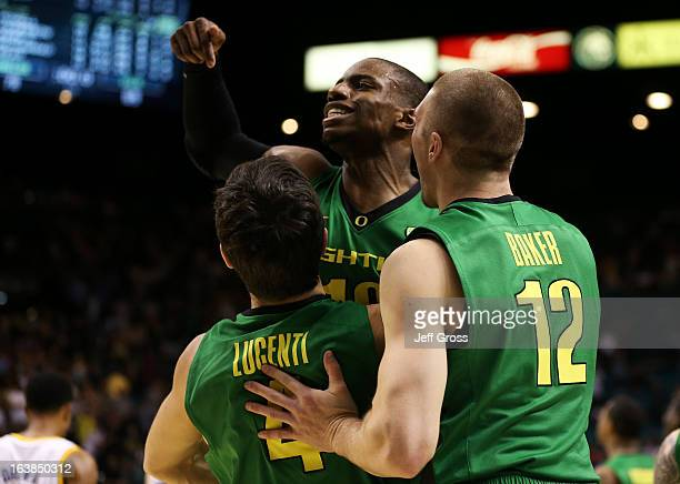 Johnathan Loyd Nicholas Lucenti and Coleton Baker of the Oregon Ducks celebrate their 78 to 69 win over the UCLA Bruins during the Pac12 Championship...