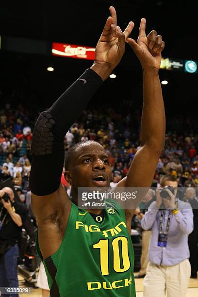 Johnathan Loyd of the Oregon Ducks celebrates their 78 to 69 win over the UCLA Bruins during the Pac12 Championship game at MGM Grand Garden Arena on...
