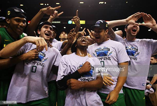 Johnathan Loyd of the Oregon Ducks celebrates with teammates after they defeated the UCLA Bruins 78 to 69 in the Pac12 Championship game at MGM Grand...