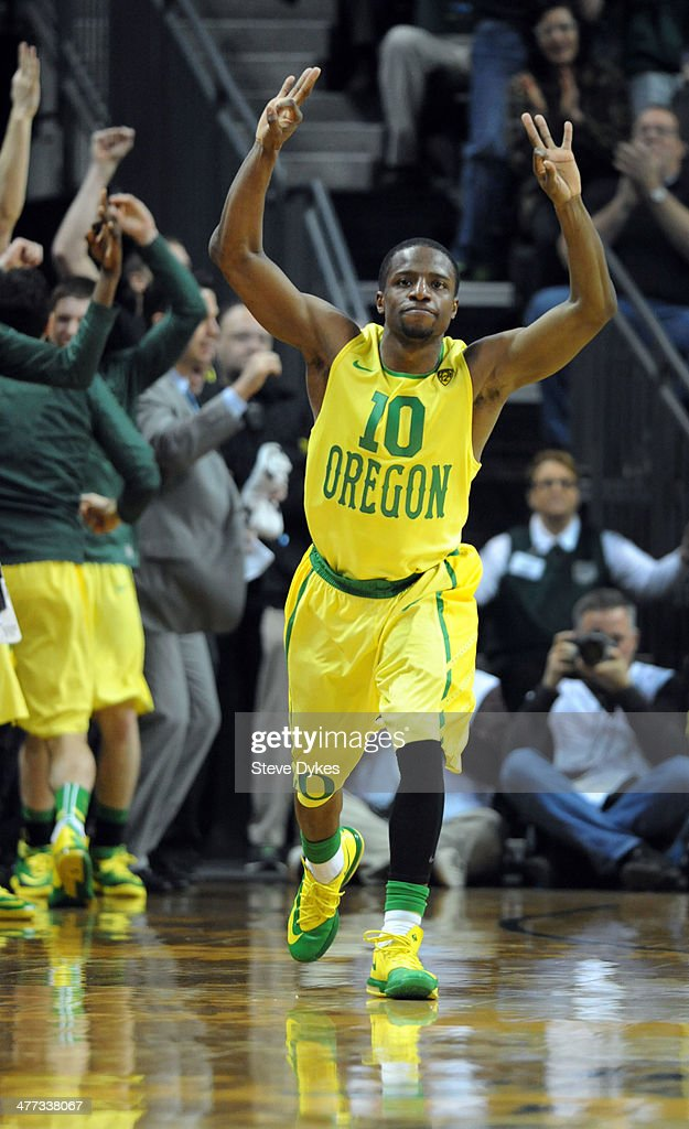 Johnathan Loyd #10 of the Oregon Ducks reacts after hitting a key three point shot during the second half of the game against the Arizona Wildcats at Matthew Knight Arena on March 8, 2014 in Eugene, Oregon. Oregon won the game 64-57.