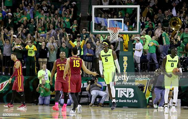 Johnathan Motley of the Baylor Bears and Jo LualAcuil Jr #0 of the Baylor Bears celebrate after beating the Iowa State Cyclones 6563 at Ferrell...