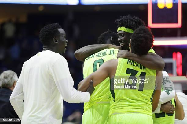 Johnathan Motley of the Baylor Bears celebrates with his teammates Terry Maston and Jo LualAcuil Jr #0 after defeating the USC Trojans during the...
