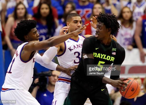 Johnathan Motley of the Baylor Bears controls the ball as Josh Jackson and Landen Lucas of the Kansas Jayhawks defend during the game at Allen...