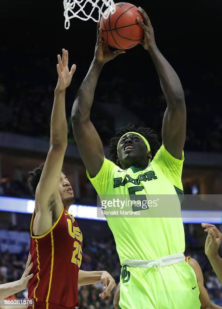 Johnathan Motley of the Baylor Bears is defended by Bennie Boatwright of the USC Trojans during the second round of the 2017 NCAA Men's Basketball...