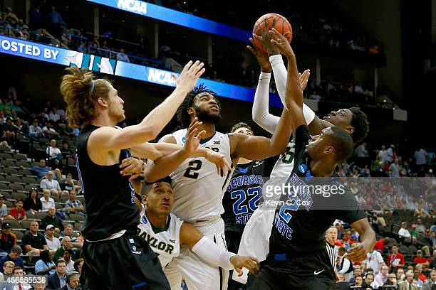 Johnathan Motley of the Baylor Bears rebounds the ball against Ryann Green of the Georgia State Panthers in the first half during the second round of...