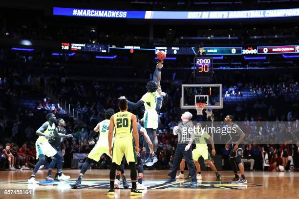 Johnathan Motley of the Baylor Bears tips off against Chris Silva of the South Carolina Gamecocks to start the first half during the 2017 NCAA Men's...