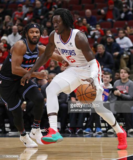 Johnathan Motley of the LA Clippers moves past Wayne Selden of the Chicago Bulls at the United Center on January 25 2019 in Chicago Illinois NOTE TO...