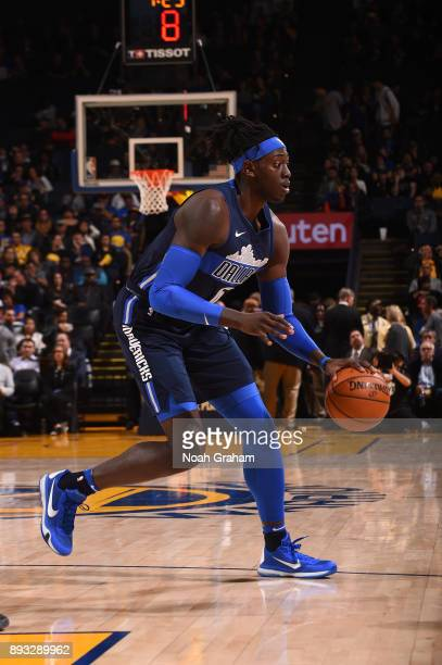 Johnathan Motley of the Dallas Mavericks handles the ball against the Golden State Warriors on December 14 2017 at ORACLE Arena in Oakland California...