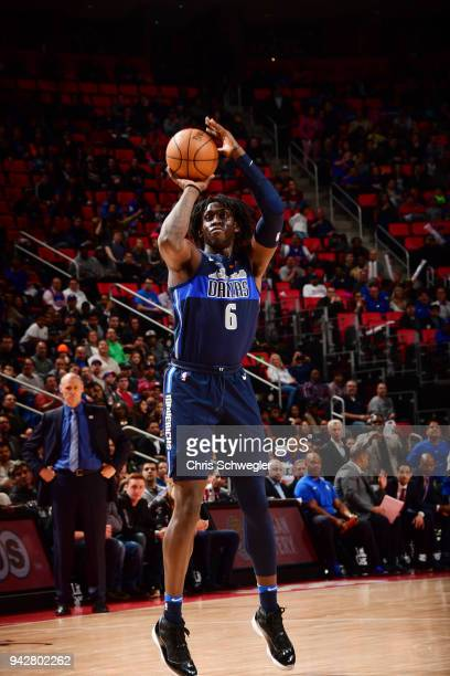 Johnathan Motley of the Dallas Mavericks shoots the ball to tie the game against the Detroit Pistons on April 6 2018 at Little Caesars Arena in...