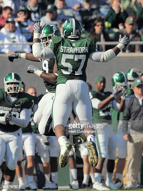 Johnathan Strayhorn of the Michigan State Spartans jumps into the air to celebrate a first quarter fumble recovery against the Western Michigan...