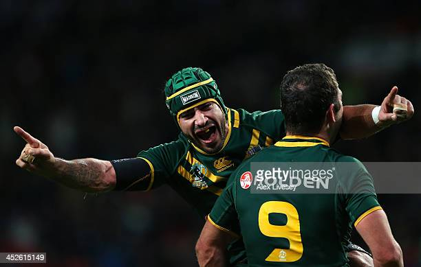 Johnathan Thurston and Cameron Smith of Australia celebrate after victory over New Zealand in the Rugby League World Cup Final between New Zealand...