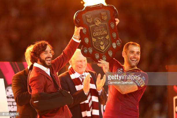 Johnathan Thurston and Cameron Smith of the Maroons hold aloft the Origin trophy after winning game three of the State Of Origin series between the...