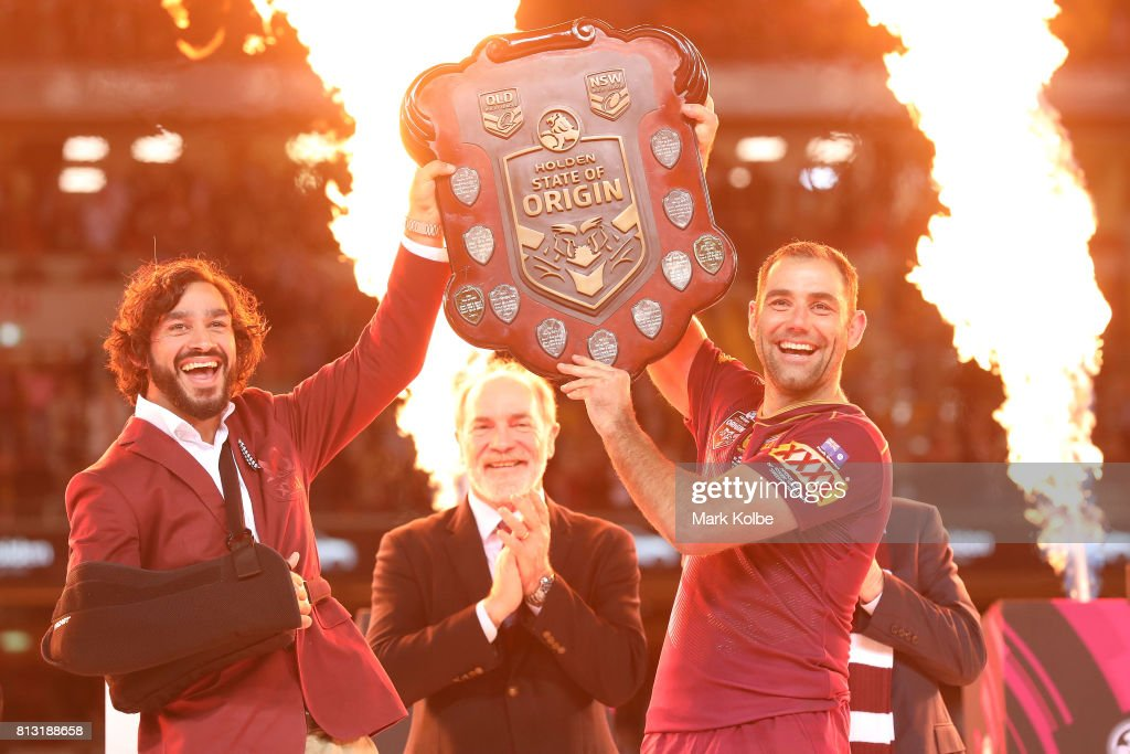 Johnathan Thurston and Cameron Smith of the Maroons hold aloft the Origin trophy after winning game three of the State Of Origin series between the Queensland Maroons and the New South Wales Blues at Suncorp Stadium on July 12, 2017 in Brisbane, Australia.