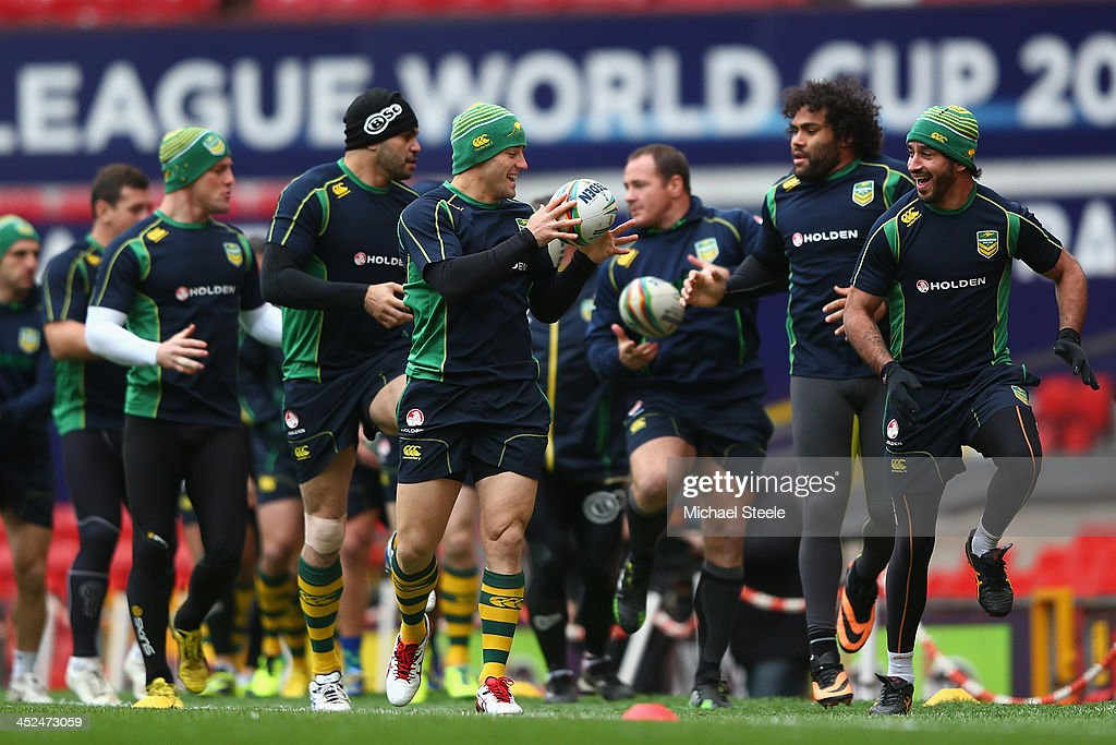 Johnathan Thurston (R) and Cooper Cronk (L) during the Australia training session at Old Trafford on November 29, 2013 in Manchester, England.