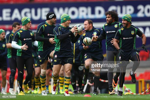 Johnathan Thurston and Cooper Cronk during the Australia training session at Old Trafford on November 29 2013 in Manchester England