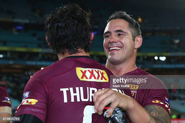 Johnathan Thurston and Corey Parker of the Maroons celebrate victory during game one of the State of Origin series between the New South Wales Blues...