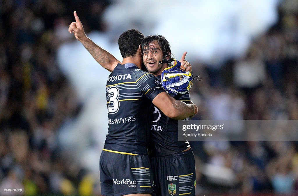 Johnathan Thurston and Justin O'Neill of the Cowboys celebrate victory after the first NRL semi final between North Queensland Cowboys and Brisbane Brisbane at 1300SMILES Stadium on September 16, 2016 in Townsville, Australia.