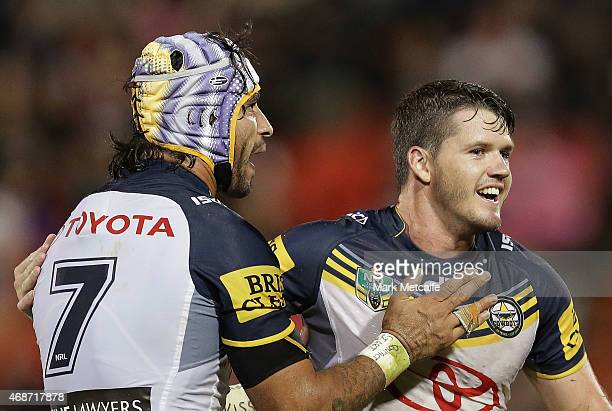 Johnathan Thurston and Lachlan Coote of the Cowboys celebrate victory in the round five NRL match between the Penrith Panthers and the North...