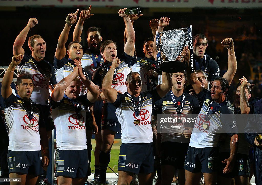Johnathan Thurston and Matthew Scott of North Queensland Cowboys lift the World Club Series trophy after victory over Leeds Rhinos in the World Club Series match between Leeds Rhinos and North Queensland Cowboys at Headingley on February 21, 2016 in Leeds, England.