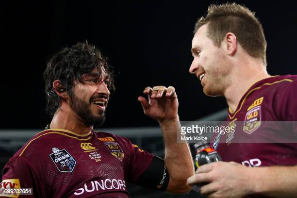 Johnathan Thurston and Michael Morgan of the Maroons celebrate victory during game two of the State Of Origin series between the New South Wales...