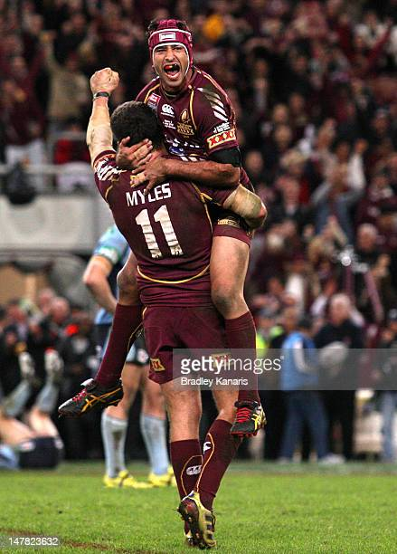 Johnathan Thurston and Nate Myles of the Maroons celebrate victory after game three of the 2012 State of Origin series between the Queensland Maroons...