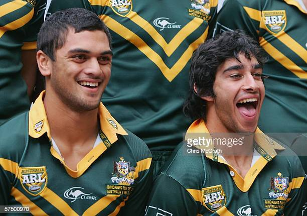 Johnathan Thurston and team mate Karmichael Hunt laugh during the team photo to be taken during the Australian Kangaroos Rugby League team photo...