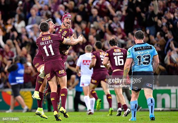 Johnathan Thurston Corey Parker and Matt Gillett of the Maroons celebrate victory as Paul Gallen of the Blues is dejected after game two of the State...