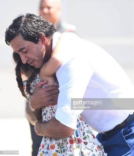Johnathan Thurston gets a hug form his eldest daughter Frankie after he gave a speech during the unveiling of the Jonathan Thurston bronze statue at...