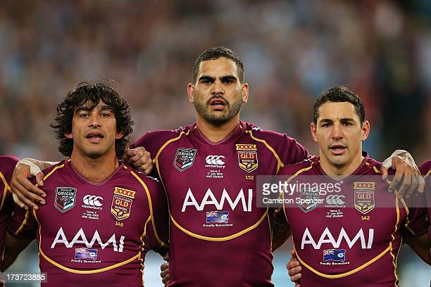Johnathan Thurston Greg Inglis and Billy Slater of the Maroons sings the national anthem before game three of the ARL State of Origin series between...