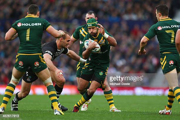 Johnathan Thurston of Australia sidesteps Simon Mannering of New Zealand during the Rugby League World Cup Final between Australia and New Zealand at...