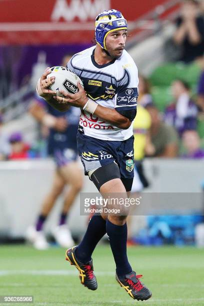 Johnathan Thurston of the Cowboys accepts a pass during the round three NRL match between the Melbourne Storm and the North Queensland Cowboys at...