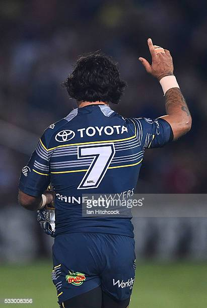 Johnathan Thurston of the Cowboys acknowledges the crowd at the start of the round 11 NRL match between the North Queensland Cowboys and the Brisbane...
