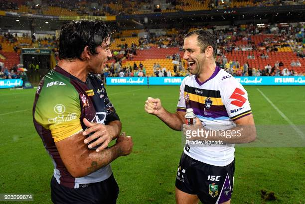 Johnathan Thurston of the Cowboys and Cameron Smith of the Storm share a laugh after the NRL trial match and Jonathan Thurston/Cameron Smith...