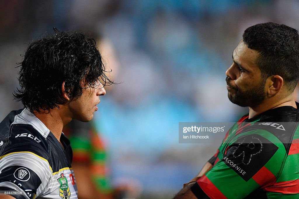 Johnathan Thurston of the Cowboys and Greg Inglis of the Rabbitohs talk to each other after the round 17 NRL match between the South Sydney Rabbitohs and the North Queensland Cowboys at Barlow Park on July 3, 2016 in Cairns, Australia.