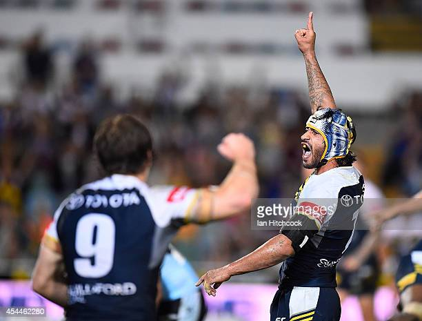 Johnathan Thurston of the Cowboys celebrates after kicking the winning field goal during the round 25 NRL match between the North Queensland Cowboys...