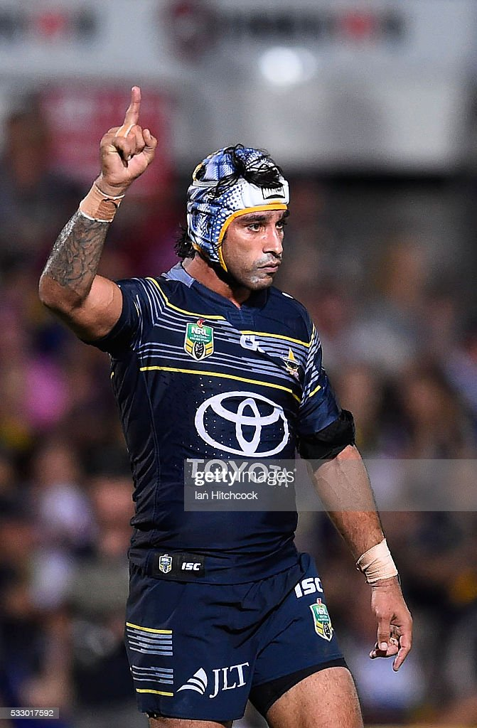 Johnathan Thurston of the Cowboys celebrates after winning the round 11 NRL match between the North Queensland Cowboys and the Brisbane Bronocs at 1300SMILES Stadium on May 20, 2016 in Townsville, Australia.