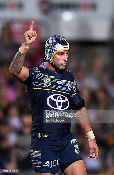 Johnathan Thurston of the Cowboys celebrates after winning the round 11 NRL match between the North Queensland Cowboys and the Brisbane Bronocs at...