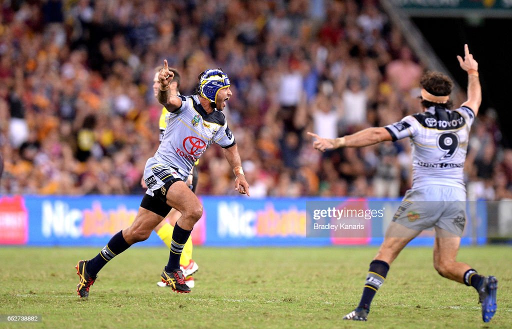 Johnathan Thurston of the Cowboys celebrates victory after kicking the field goal to snatch victory in extra time during the round two NRL match between the Brisbane Broncos and the North Queensland Cowboys at Suncorp Stadium on March 10, 2017 in Brisbane, Australia.