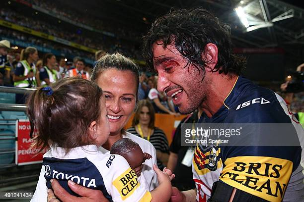 Johnathan Thurston of the Cowboys celebrates victory with his wife Samantha Lynch and daughter after the 2015 NRL Grand Final match between the...