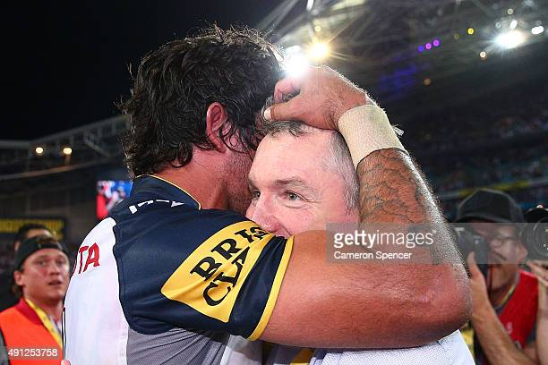 Johnathan Thurston of the Cowboys celebrates with Cowboys coach Paul Green after winning the 2015 NRL Grand Final match between the Brisbane Broncos...