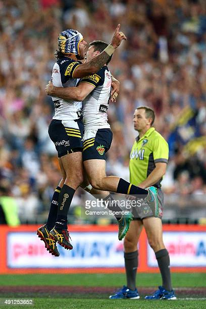 Johnathan Thurston of the Cowboys celebrates with Lachlan Coote of the Cowboys after kicking a field goal in extratime to win the 2015 NRL Grand...
