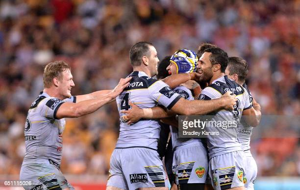 Johnathan Thurston of the Cowboys celebrates with team mates after kicking the winning field goal in extra time during the round two NRL match...