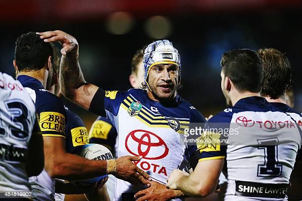 Johnathan Thurston of the Cowboys celebrates with the team during the round 24 NRL match between the New Zealand Warriors and the North Queensland...