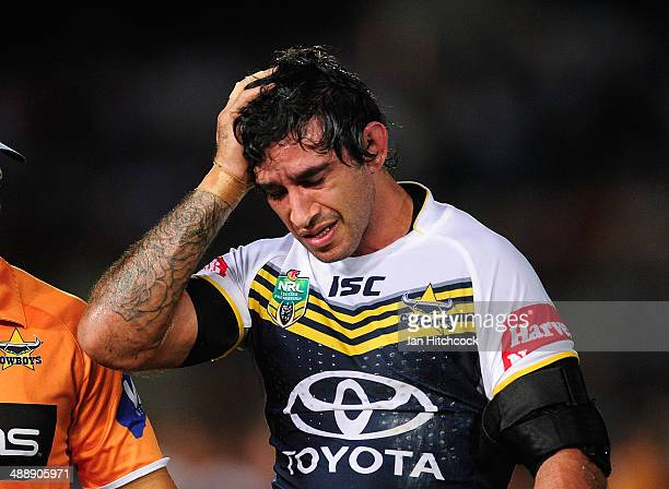 Johnathan Thurston of the Cowboys comes off the field after being injured during the round nine NRL match between the North Queensland Cowboys and...